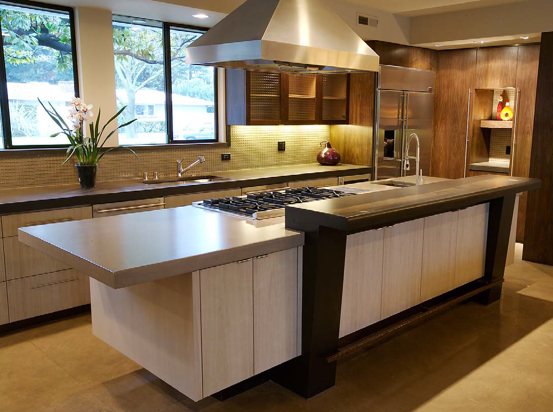 A complete concrete kitchen with countertops and decor that create this perfect central point to this concrete home.