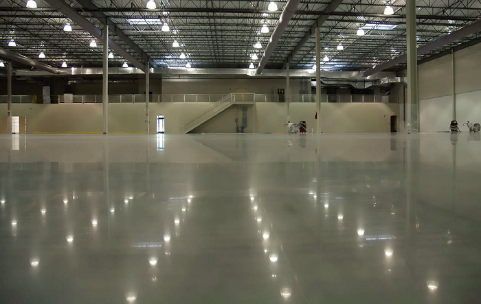 "Cuviello Concrete achieved the clarity of reflection in this floor by fully refining the surface. ""We do not skip any grits in our eight-step grit sequence, and we always drop back one grit size with a separation of at least 50 when we transition from metal to resin abrasive,"" says owner Jim Cuviello."