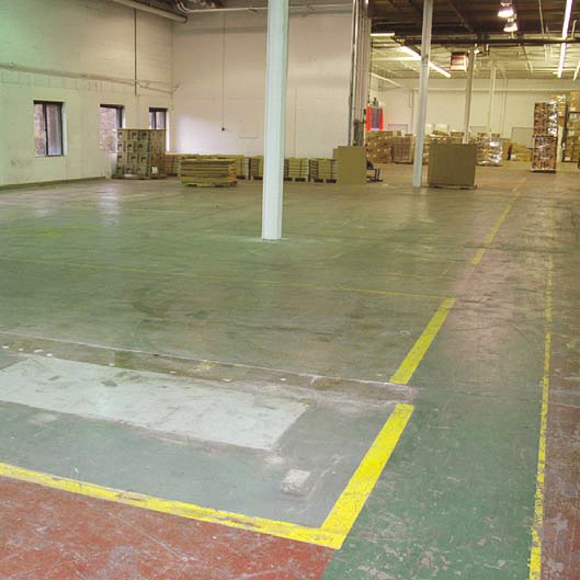 The epoxy on this lighting factory floor was removed with a scarifier.