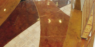 Different sections of this church lobby floor were colored by reds oranges and whites.
