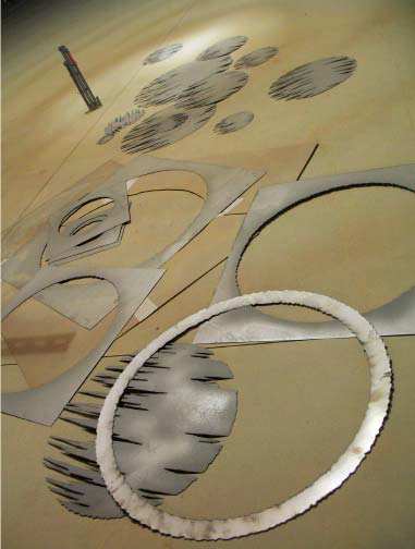 A beach theme was illustrated through plasma-cut steel templates of stylized pier images