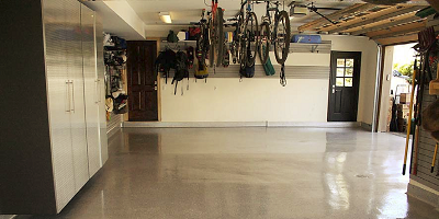 Garage floor polyaspartic floor. Bikes hanging from the ceiling.
