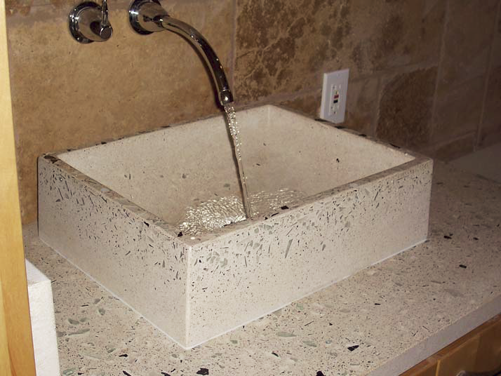 Jim Ralston of Urban Concrete Design uses GFRC exclusively when making countertops and fireplaces. His application methods involve a peristaltic pump and a spray gun, as well as hand-packing.