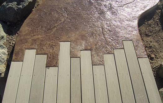 Concrete and Trex deck meeting up together to make a seamless transition between the two building materials.