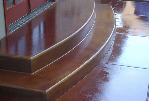 Beautiful stained concrete steps in a rustic brown shade.
