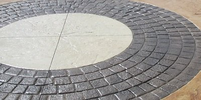 Large stamped concrete circles with beige inner textured circles