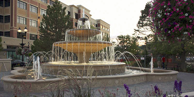 a grand, European-style fountain, more than 16 feet tall with four falls.