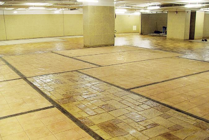 The massive parking-garage makeover began when Sadleir traveled to Hong Kong to fine-tune Lau's crew on the quarter-inch stamping technique.