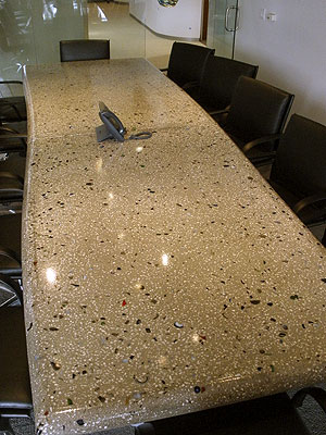 A look a the concrete conference table that was inlayed with glass and curved for a more artistic look.