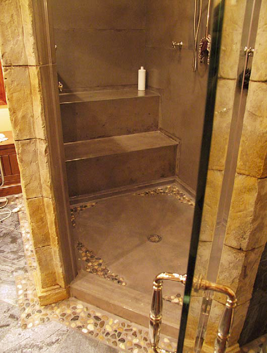 A residential steam shower that utilizes GFRC wall and ceiling panels and molded seating to keep moisture from escaping.