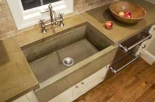 Industrial looking concrete countertop with a custom made built in basin sink.