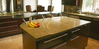 Concrete countertop in a kitchen with bananas on top.