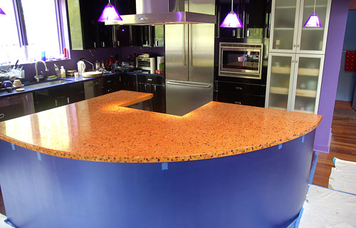 Stone Soup Concrete used bright colors or orange and purple in this concrete countertop.