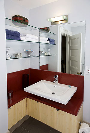 Stone Soup Concrete used a bright red on this concrete countertop bathroom vanity.