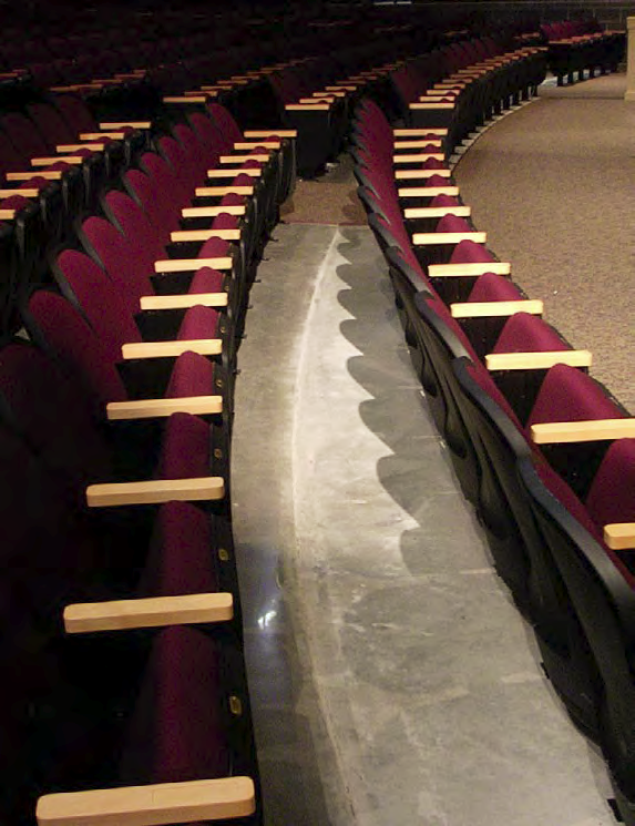 This auditorium at Millstone Township Middle School, N.J., features a combination of carpet and exposed concrete. Joe Smith, Natural Stone Care, Media, Penn., hardened and densified the floor and polished to an 800-grit resin finish.