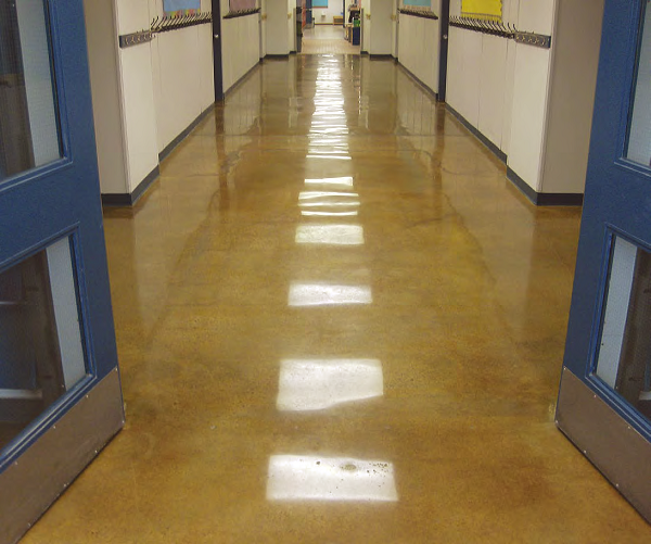 Clint Buswell, Concrete by Design, Alberta, Canada, created the floor in this hallway at St. Matthew's Middle School, Rocky Mountain House, Alberta. He used Prosoco's Consolideck LS lithium-silicate hardener/densifier and a caramel-color acetone stain to do it. The floor is polished to an 800-grit resin finish, and the glossy microthin lithium-silicate-containing protective coating has been burnished in at 3,000 rpm.
