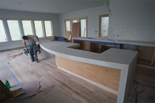 Installing a concrete countertop with a round bar.