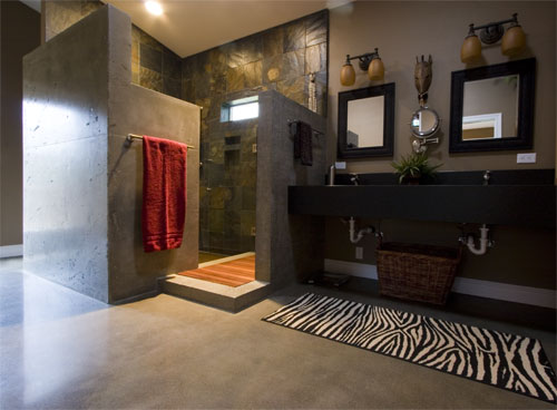 A sleek upscale concrete bathroom with animal print accents.