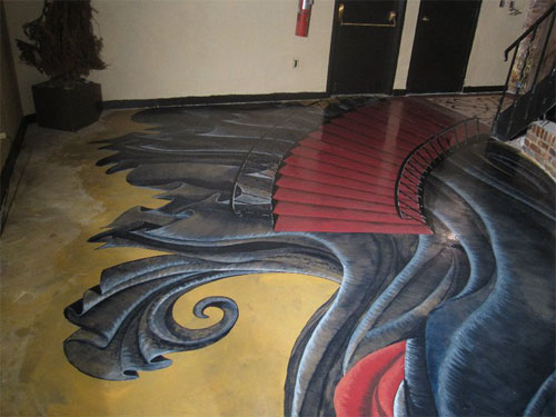 3-D effect of The Phantom of the Opera stained onto this concrete floor.