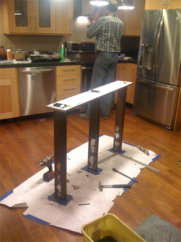 Reinforcing the heavy concrete countertop with steel supports.