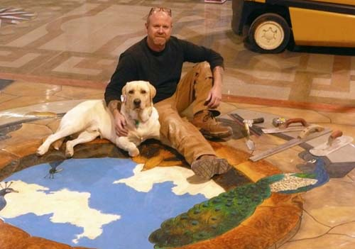 Bob Harris and his dog Zeke on a finished concrete floor.