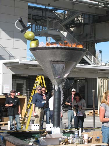 The concrete martini glass with flames and water.
