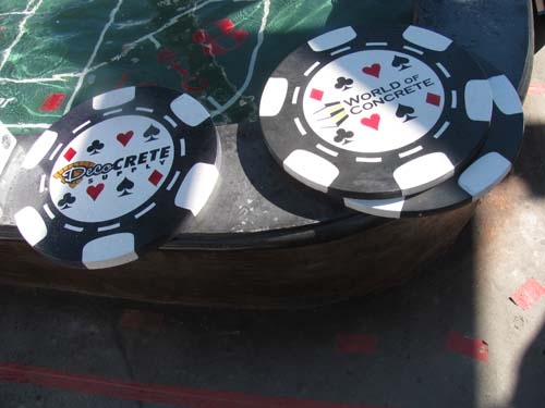 Larger than life poker chips made of concrete.