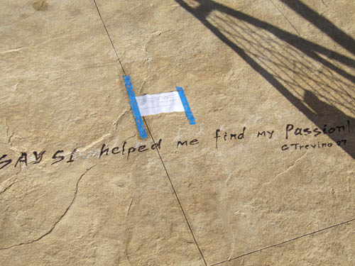 The quote that Say Si helped this student find their passion is placed in the concrete permanently.