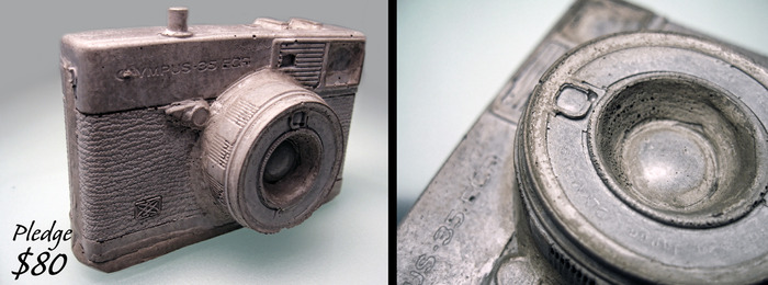 Concrete casted camera that comes with a specific pledge amount.