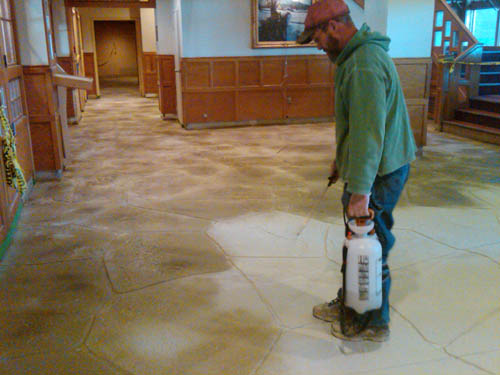 Applying the concrete stains to the floor in the ski resort.