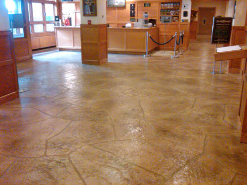 The floor was created by using a thin stampable overlay and other materials from Elite Crete Systems to put down the look of unique large stones.