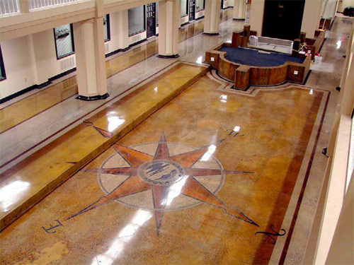 stained concrete floor with compass design