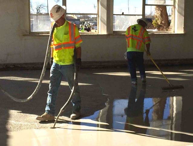 two contractors troweling concrete