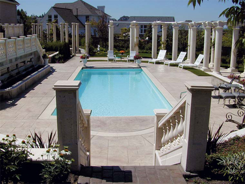 stamped concrete pool deck with gorgeous stair entrance