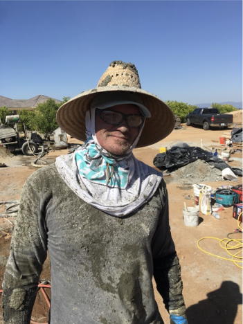 joshua annis wearing protective clothing on job site doing shotcrete
