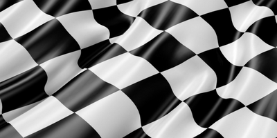 Car racing winning black and white checkered flag.