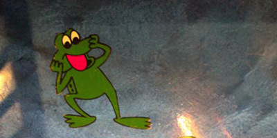 Frog on the floor of the retail space adds a playful element to the theme park.