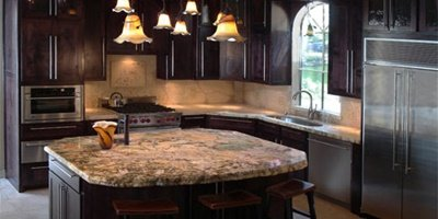 Kitchen remodel with concrete and granite blending together harmoniously.