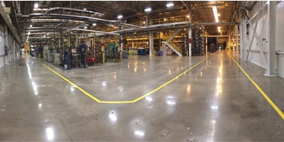 polished concrete floors in a large sheet metal stamping plant