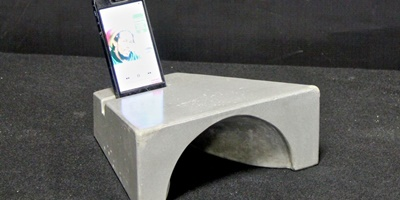 Concrete speaker amplification created with Buddy Rhodes mix