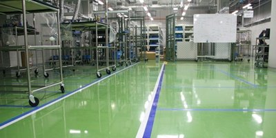 Green anti-static epoxy floor in manufacturing plant.