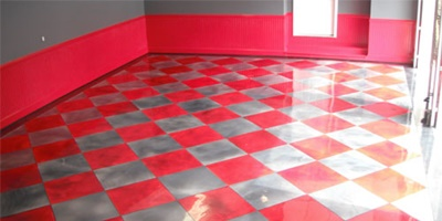Red and gray epoxy floor in a garage.