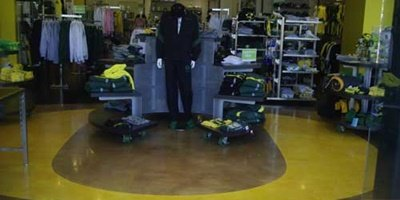 The Duck Store in Portland, Oregon gets an epoxy coating and the O logo placed on it.