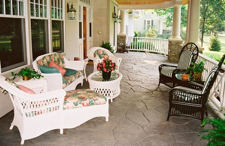 Patio with stamped concrete and different patio chairs.