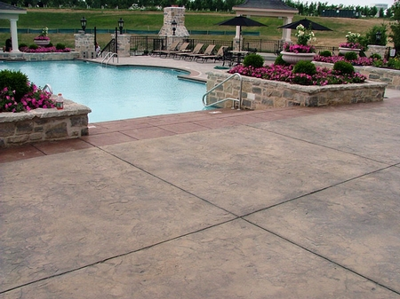 Stamped and stained concrete pool deck.