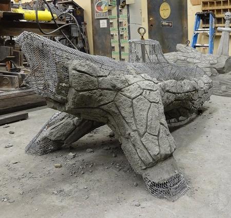 A concrete log for sitting, pre color.