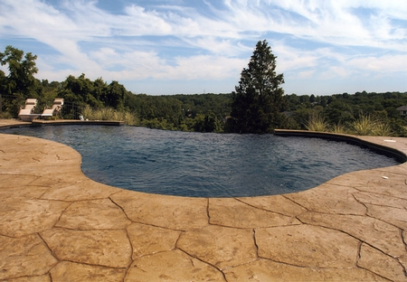 Infinity edge pool that is surround by a custom stamped pool deck.