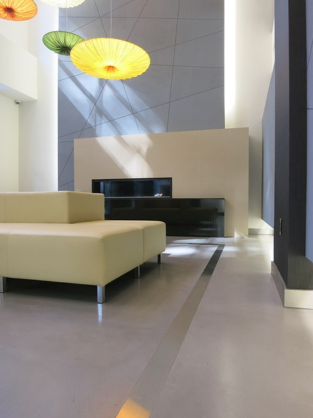 Polished concrete floor with a modern sofa.