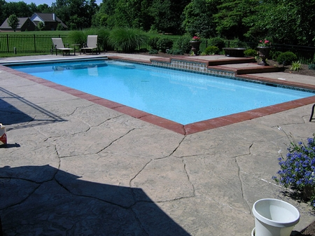 Natural stone concrete stamp pool deck.