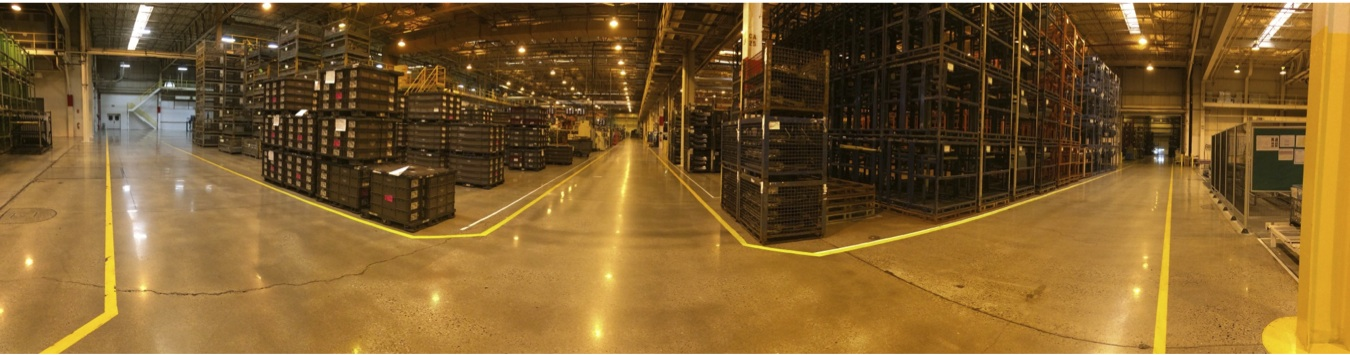 Panoramic view of warehouse aisle